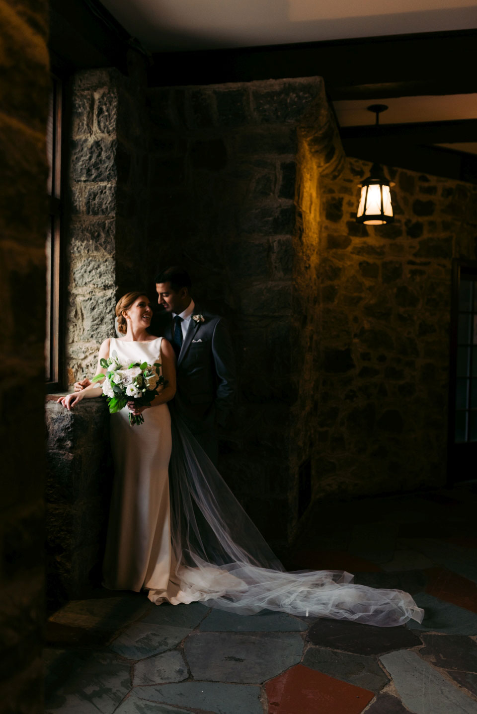 Bride and Groom Window Pose | Fairmont Chateau Montebello | Anne Marie Bouchard Photography