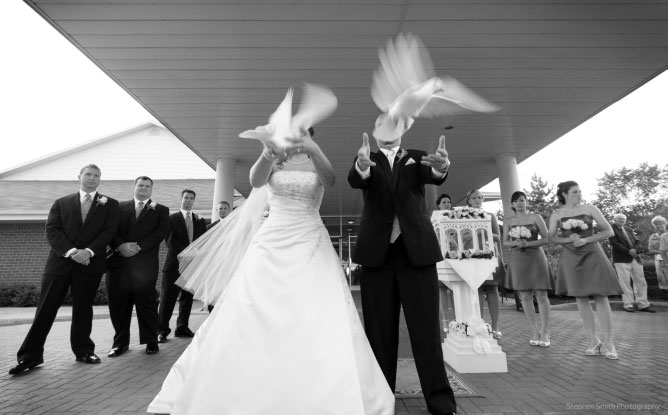 Bride and Groom in front of church with doves | Stephen Smith Photography | The Life Centre