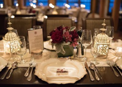 Vintage charger with red roses orchids and dusty miller burlap runner | The Ivy Lea Club | AMBPhoto