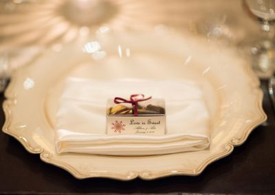 Vintage cream charger plate with napkin and truffles | The Ivy Lea Club | AMBPhoto