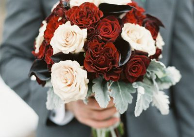 Bride bouquet red blush roses calla lilies dusty miller | The Ivy Lea Club | AMBPhoto