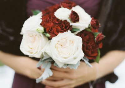 Bridemaid in burgundy with white and red bouquet | The Ivy Lea Club | AMBPhoto