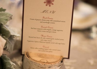 Cream and burgundy with snowflake menu on birch stump | The Ivy Lea Club | AMBPhoto