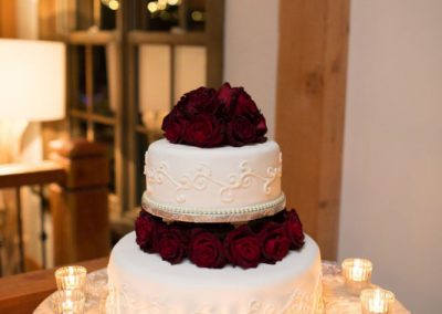 White wedding cake with red rose topper | The Ivy Lea Club | AMBPhoto