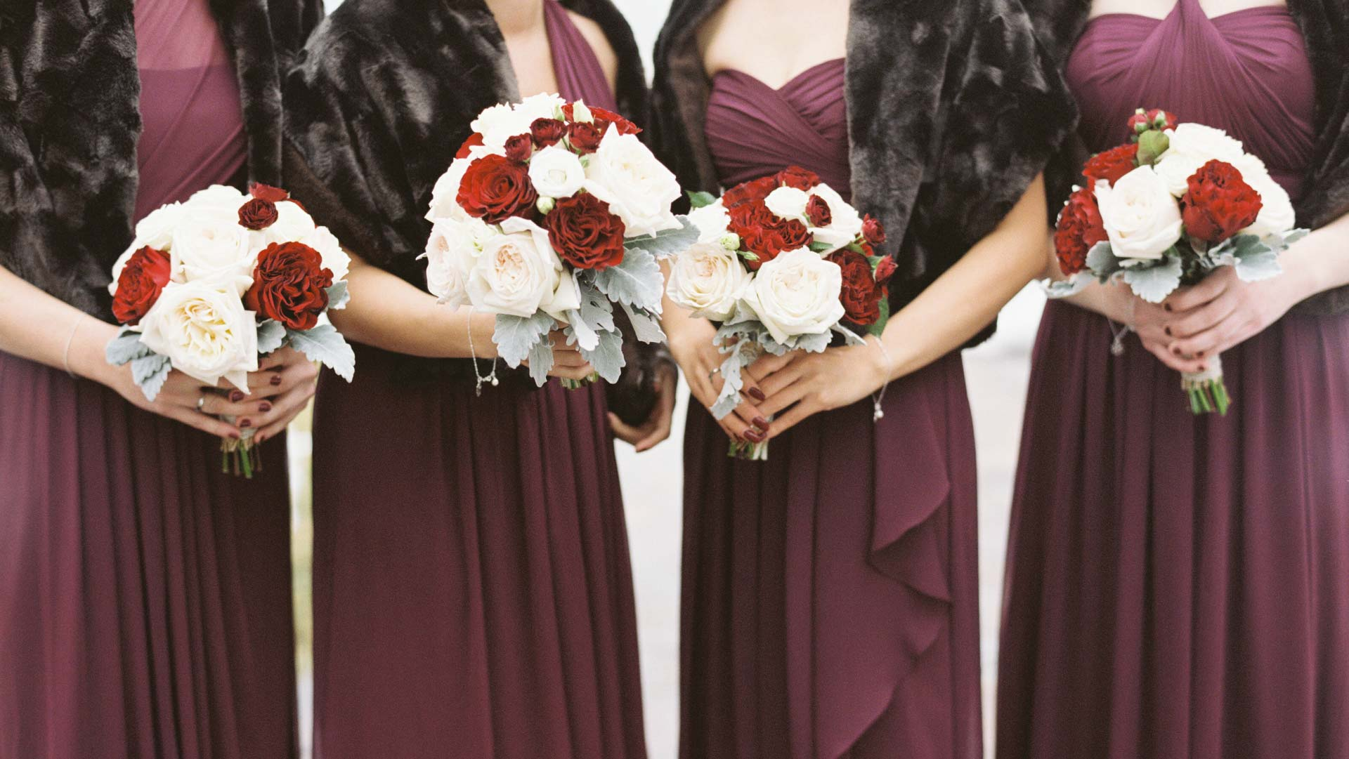 Burgundy bridesmaids with fur stoles white and red bouquet | The Ivy Lea Club | AMBphoto