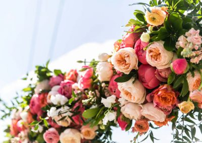 Ceremony archway with coral pink florals | Britannia Yacht Club | Union Eleven Photographers