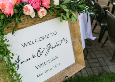 Ceremony with welcome sign wood frame | Britannia Yacht Club | Union Eleven Photographers