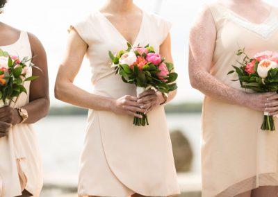 Bridesmaids blush dresses with coral pink bouquet | Britannia Yacht Club | Union Eleven Photographers