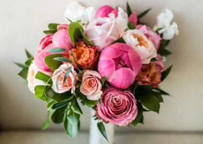 Bouquet with greenery pink corral blush peach peonies and roses | Union Eleven Photographers