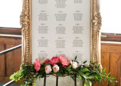 Gold framed seating chart coral pink flowers | Britannia Yacht Club | Union Eleven Photographers