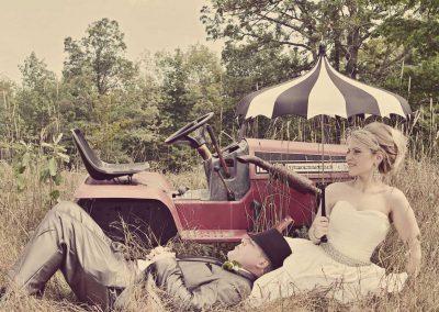 Bride and groom red antique tractor | Sala San Marco | Renaissance Studios