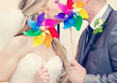 Bride and Groom with colorful pinwheels | Sala San Marco | Renaissance Studios