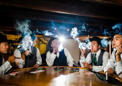 Groom and groomsmen smoking cigars photo | Stonefields Heritage Farm | Themotions Photography
