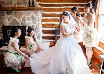 Bridesmaids ivory dresses green belts | Stonefields Heritage Farm | Themotions Photography