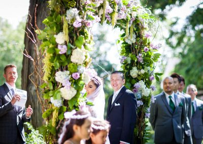 Floral archway wedding ceremony | Stonefields Heritage Farm | Themotions Photography