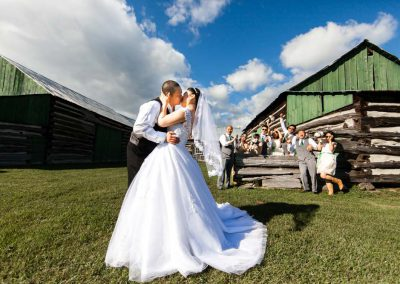 Couple kissing bridal party barn wedding | Stonefields Heritage Farm| Themotions Photography