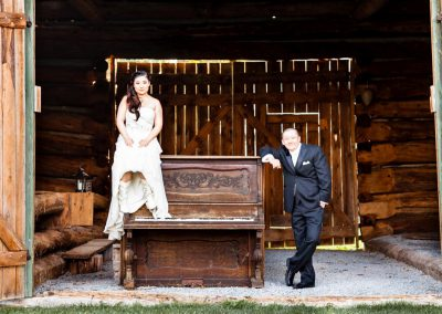 Couple photo barn wedding with antique piano | Stonefields Heritage Farm | Themotions Photography