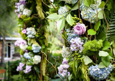 White green purple floral wood archway | Stonefields Heritage Farm | Themotions Photography