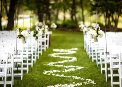 Outdoor ceremony white chairs white aisle petal design | Stonefields Heritage Farm | Themotions Photography