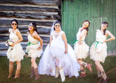 Bride and bridesmaid cowboy boots | Stonefields Heritage Farm | Themotions Photography