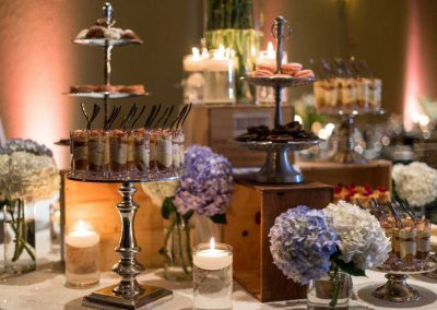 Dessert bar with silver tiered stands flowers and champagne crates | Fairmont Chateau Montebello | Urban Bent Studio