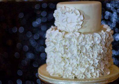 Ruffled white wedding cake on vintage silver cake stand | Fairmont Chateau Montebello | Urban Bent Studio