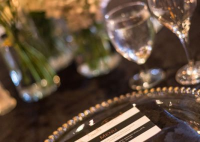 Black and white striped menu with gold beaded glass charger | Fairmont Chateau Montebello | Urban Bent Studio
