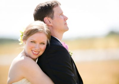 Newlyweds in wheat field | Private Residence Wedding | Union Eleven Photographers