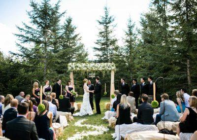Ceremony floral arbour hay bails petal aisle | Private Residence Wedding | Union Eleven Photographers