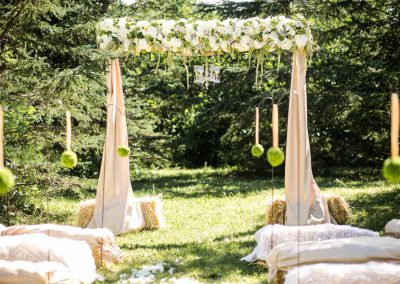 Floral arbor burlap green and white florals chandelier | Private Residence Wedding | Union Eleven Photographers
