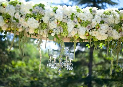 White Green with chandelier floral arbor ceremony | Private Residence Wedding | Union Eleven Photographers