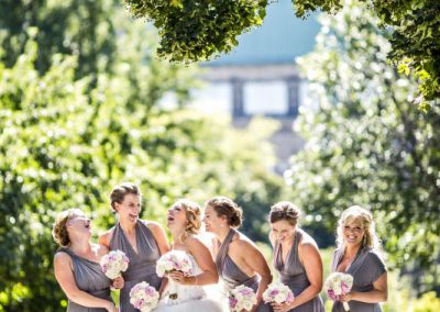 Laughing bridal party in grey Twobirds dresses | Fairmont Chateau Laurier | Union Eleven Photographers
