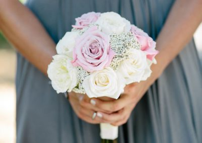 Bridesmaid in grey with white cream blush pink bouquet | Fairmont Chateau Laurier | Union Eleven Photographers