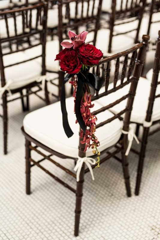 Red roses and orchid mahogany chiavari ceremony | Canadian Museum of Nature | Union Eleven Photographers
