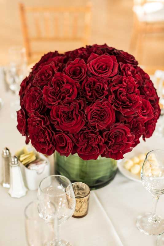 Red velvet baccara rose centerpiece gold mercury candle | Canadian Museum of Nature | Union Eleven Photographers