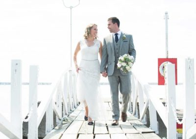 Bride and Groom Walking on Pier | Rivermead Ottawa | AMBphoto