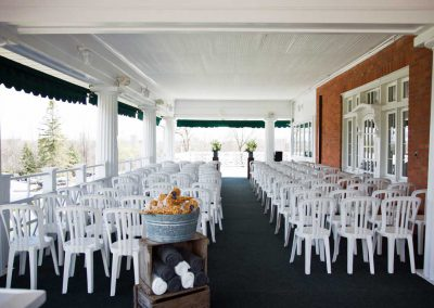 Wedding Ceremony on wraparound porch white pillars and chairs | Rivermead Golf Ottawa | AMBphoto